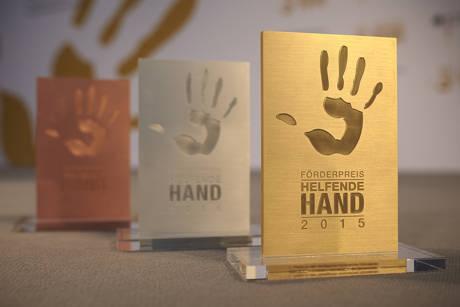"""Projekt """"UniKAT"""" der Universität Siegen erhält nationalen Förderpreis """"Helfende Hand"""" für die Unterstützung des Ehrenamtes."""